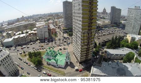 RUSSIA, MOSCOW - JUN 6, 2014: Church of St. Simeon Stylites near New Arbat street with traffic at sunny summer day. Aerial view. Photo with noise from action camera