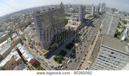 RUSSIA, MOSCOW - JUN 6, 2014: City traffic on New Arbat street at sunny summer day. Aerial view. Photo with noise from action camera