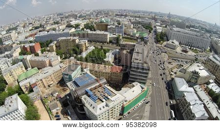 RUSSIA, MOSCOW - JUN 6, 2014: Aerial view of cityscape with traffic on New Arbat street. Photo with noise from action camera