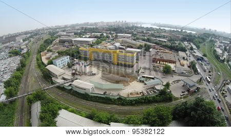 RUSSIA, MOSCOW - JUN 7, 2014: Aerial view of cityscape and cement - concrete factory, Mechanization-2. Photo with noise from action camera