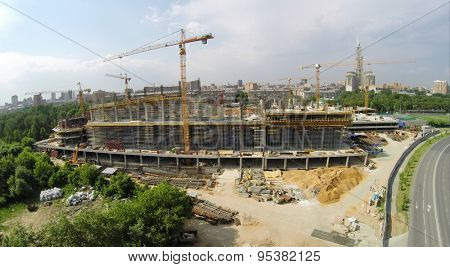 RUSSIA, MOSCOW - JUN 6, 2014: Cityscape with construction site of football stadium CSKA at summer sunny day. Photo with noise from action camera