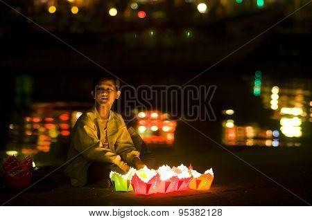 Little girl sell flower garlands in Hoian ancient town