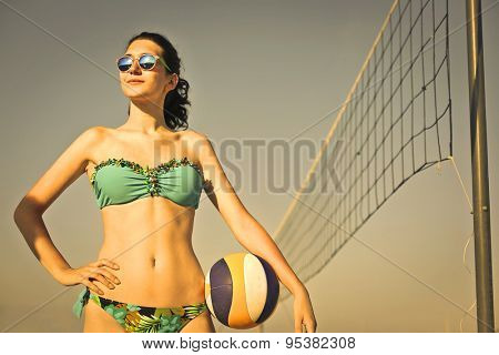 Beautiful girl playing beach volley