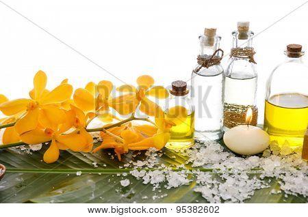 Spa set on banana leaf with pile of salt ,many oil