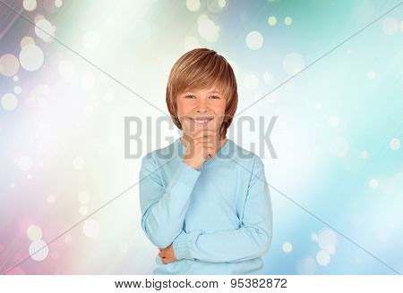 Pensive preteen boy with a blue background with sparkles