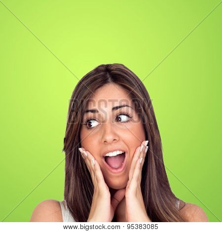 Crazy woman surprised on a green background