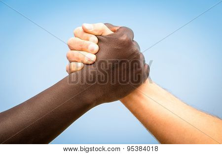 Black And White Human Hands In A Modern Handshake To Show Each Other Friendship And Respect
