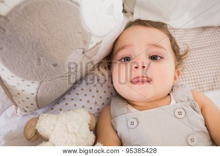 Portrait of a child in hid bed with pillow at home in bedroom