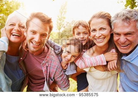 Multi-generation family having fun together outdoors