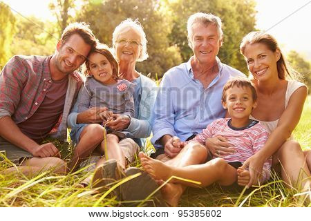 Multi-generation family relaxing together outdoors