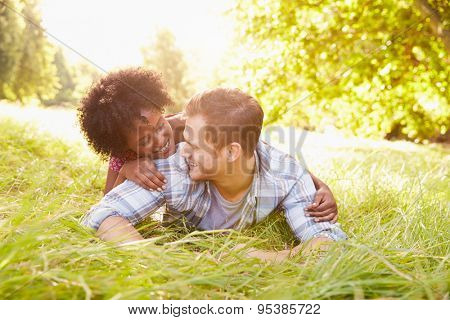 Couple having fun together in the countryside, looking at each other