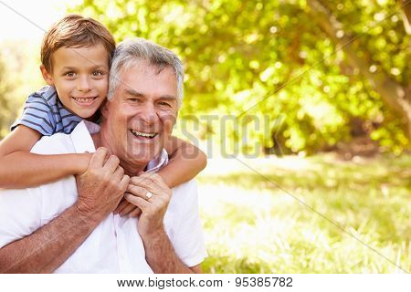 Grandfather having fun outdoors with his grandson, portrait