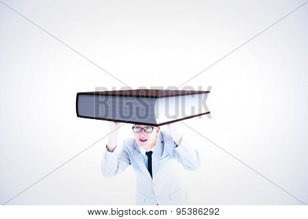 Businessman peeking against white background with vignette