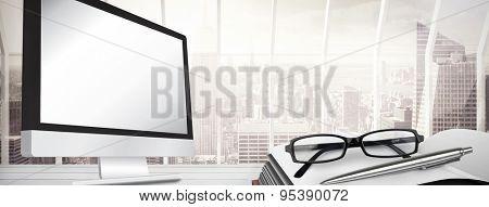 Computer screen against window overlooking city