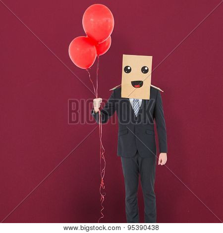 Anonymous businessman against red background