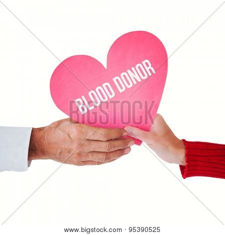 Couple holding heart against blood donor