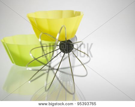 whisk and the silicone muffin holder