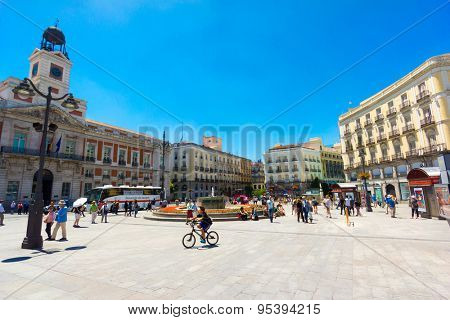 MADRID - JUNE,18: Tourists visit famous place Plaza Puerta del Sol on June 18, 2015 in Madrid