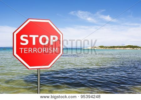 Sign Stop Terrorism on the beach