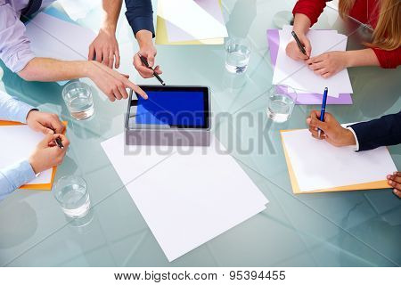 Business meeting teamwork aerial table view with hands papers and touch pad at office