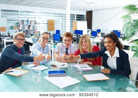 Multi ethnic business meeting thumbs up gesture happy smiling teamwork