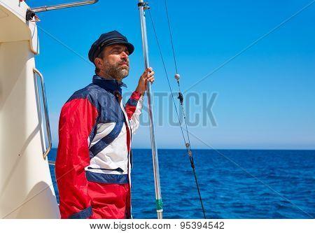 Beard sailor man sailing sea ocean in a boat with captain cap