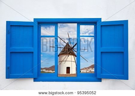 Almeria view from blue window of Cabo de Gata windmill photo mount