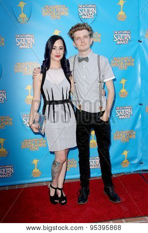 BURBANK - JUNE 25: Erik Knudsen and guest arrive at the 41st Annual Saturn Awards on Thursday, June 25, 2015 at the Castaway Restaurant in Burbank, CA.