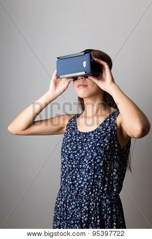Asian woman using the VR device