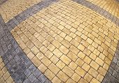picture of distortion  - Top view of the pavement of rectangular stones with wide angle distortion view - JPG