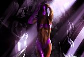 foto of cave woman  - Fitness muscular woman in purple bikini outfit and mask posing among stone women statues illustration - JPG