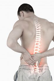 picture of spine  - Digital composite of Highlighted spine of man with back pain - JPG