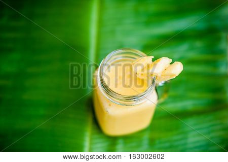 Pineapple Cocktail With A Slice Of  On  Banana Leaf. Tropical  Concept