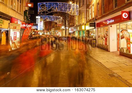 NOTTINGHAM ENGLAND - DECEMBER 22: Vodafone and various shops at night Christmas Clumber Street in Nottingham. In Nottingham England. On 22nd December 2016.