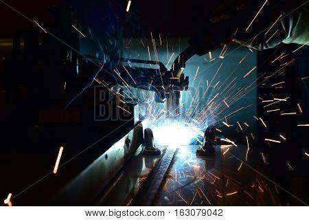 Welding robots movement in a car factory welding robot welding splashes brews argon