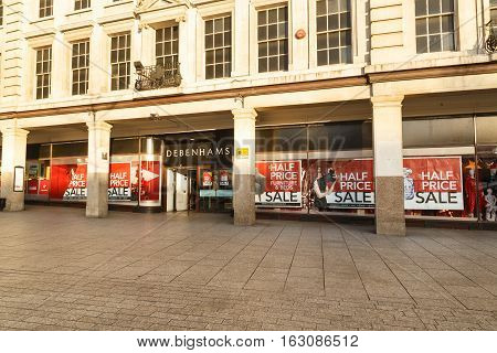 NOTTINGHAM ENGLAND - DECEMBER 26: Half price sale posters in windows at Debenhams. In Nottingham England. On 26th December 2016.