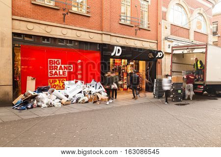 NOTTINGHAM ENGLAND - DECEMBER 26: Trash outside Boxing Day sale starts at JD Sports shop in Nottingham. In Nottingham England. On 26th December 2016.