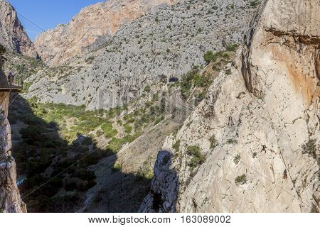 Visitors taking pictures to climbers at Caminito del Rey path Malaga Spain