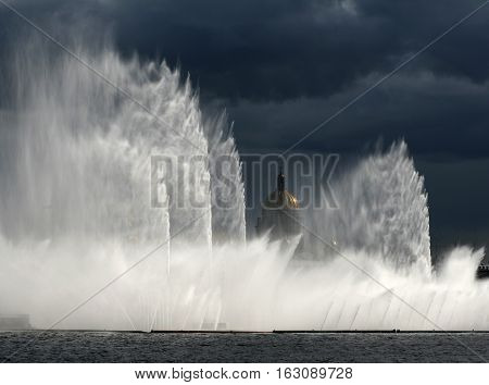 Fountain in St. Petersburg rainbow St. Isaac's Cathedral clouds