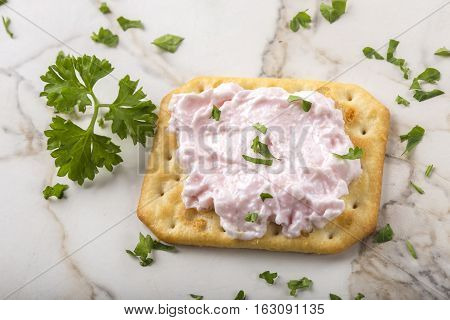 Thin crispy crackers with carp roe salad with herbs