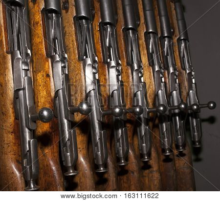 A few old rifles discharged in storage in a vertical position