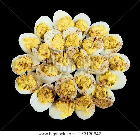 Delicious devilled eggs on a black background