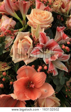 Mixed pink flower arrangement amaryllis lilies and roses