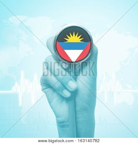 hand holding stethoscope with Antigua and Barbuda flag.