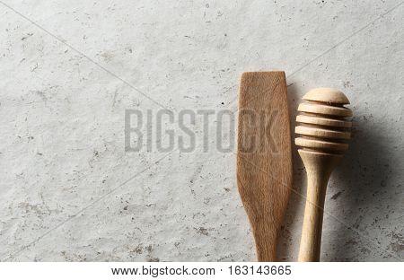 Wooden dipper kitchenware white wood board background