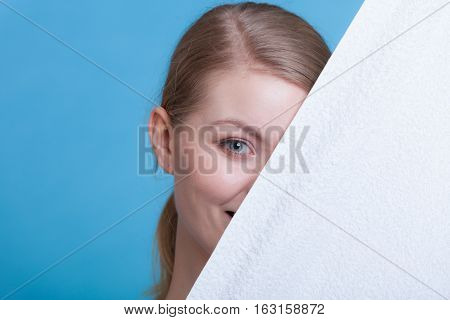 Woman Hiding Behind Big White Clean Towel
