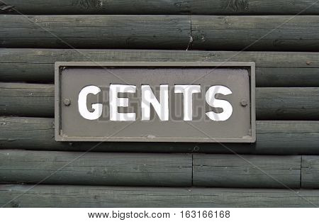 Gents toilet sign on the wood wall