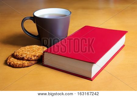 Tea with cookies and book. Selective focus
