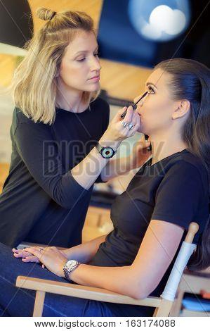 Makeup Artist Applying Mascara