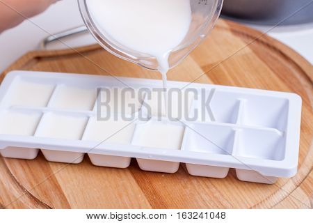 Freeze milk cubes on a wooden board